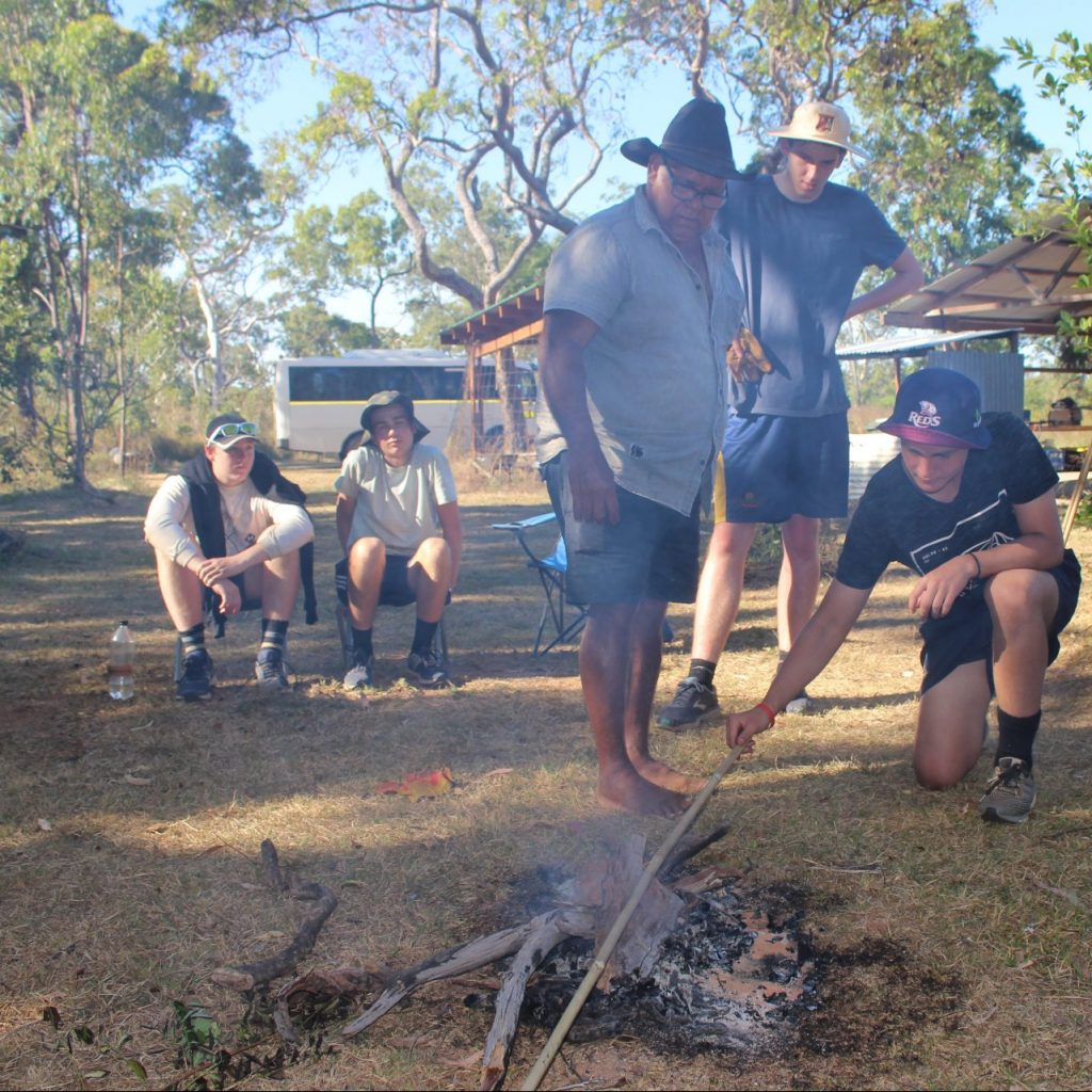 St Joseph's Gregory Terrace learning spear making with an Elder on Red Earth Indigenous Cultural Immersion in Cape York