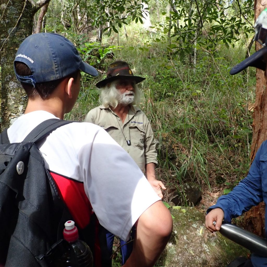 Marcellin College Randwick in Cape York learning about bush medicine and bush tucker from a Traditional Owner on Red Earth Indigenous Service Learning Immersion